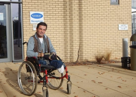 Inspirational wheelchair-user cleans street paths and signs